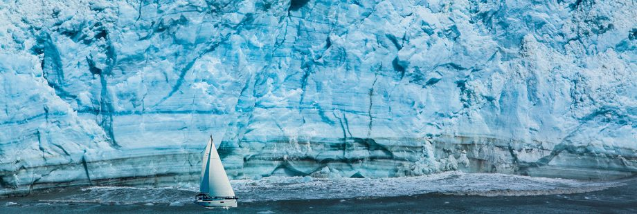 Sailing boat with a glacier in the background