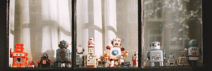 Toy robots behind the window